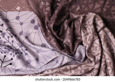 the texture of the hijab patten fabric. Patten scarf. Hijab with abstract and leaf motifs. gray, purple, light brown