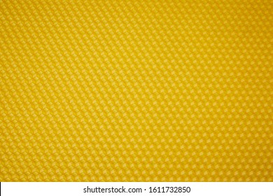Texture of honeycomb. Bright yellow background. Honey cells. Top view. Honey cell pattern, mosaic background, isolated on white