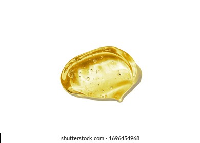 The texture of hyaluronic acid, serum gel. Transparent smear of gel isolated on a white background. Close-up, macro