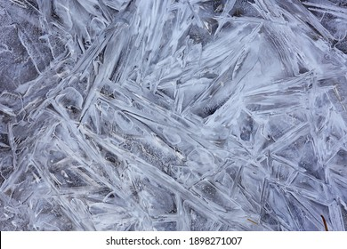 texture ice cracks, white ice crystals, winter frost background