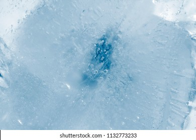 texture of ice created by air bubbles and cracks background