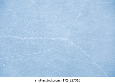 texture of ice skates traces on the blue ice