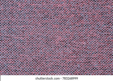 Texture of jacquard. Pink or gray background.