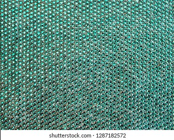 The texture of the knitted fabric, covered with small rhinestones. Thin yarn turquoise color. For textures, backgrounds.