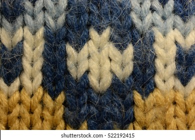 the texture of a knitted sweater wallpaper
