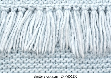 The texture of knitted wool fabric of purl loops with fringe