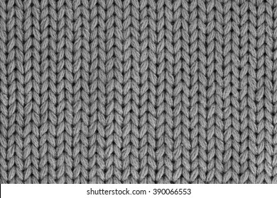 The texture of a knitted wool gray. Background