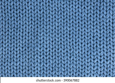 The texture of a knitted woolen fabric blue. Background