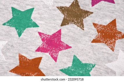 Texture of knitting fabric with the image of multi-colored stars