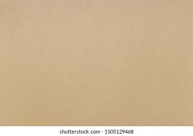 Texture of kraft color sketchbook paper. Beautiful soft brown color paper background.