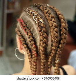 texture of krupnyeh braids on the head, rows, cornRow