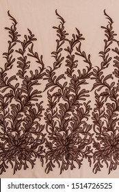 Texture lace fabric. lace on white background studio. thin fabric made of yarn or thread. a background image of ivory-colored lace cloth. Brown lace on beige background.