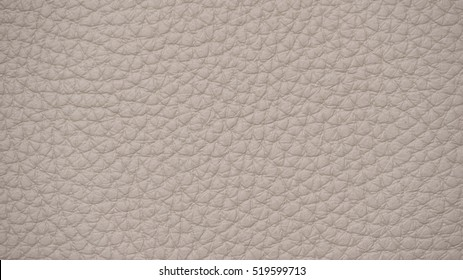 The texture of leather. Upholstery leather for upholstery, car interiors. color taupe