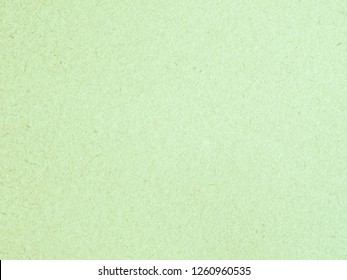 Texture of light green cardboard closeup, abstract paper background
