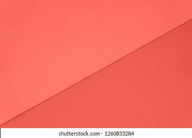 Texture of living coral colored paper for watercolor and pastel. Modern luxury background divided diagonally. Pantone color of the year 2019