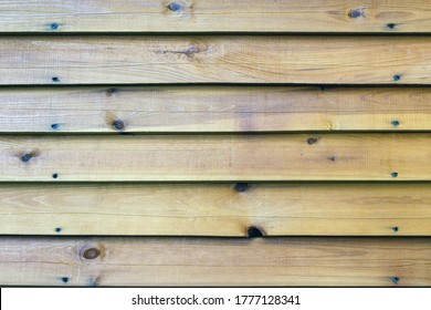 The texture of the long wooden boards overlap