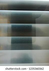 Texture of louver or jalousie, sunlight through the jalousie. Creative background