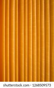 Texture of louver or jalousie, sunlight through the jalousie. Vertical lines.