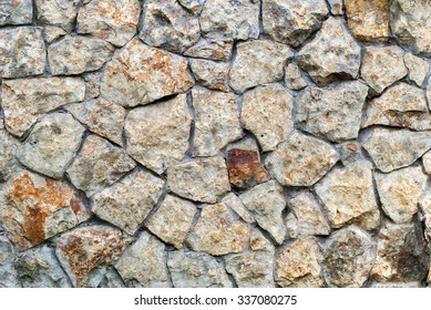 Texture of Masonry Wall of colors stones with irregular pattern. Background