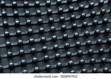 Texture: metal iron grating, grid or stainless steel grate on black background. Venting, ventilation with geometric pimpled design pattern