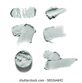 Texture of mud mask for face isolated on white background. Smears of clay for the face of an on-white background