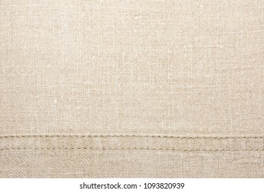 Texture of natural linen fabric with seam