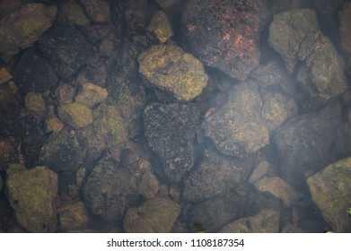 Texture of natural stones in tha dark water