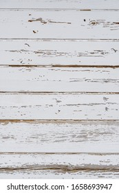 Texture od wooden planks. Wall made of antique wood painted white paint.