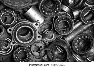 texture of old broken bearings. scrap metal background. background of different bearings
