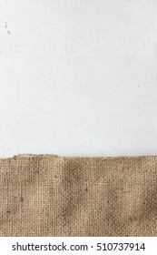 texture of the old burlap and white wooden table. over light