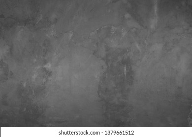 The texture of the old cement wall with scratches, cracks, dust, crevices, roughness, stucco. Can be used as a poster or background for design.
