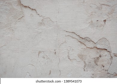 The texture of the old concrete wall with scratches, cracks, dust, crevices, roughness, stucco. Can be used as a poster or background for design.