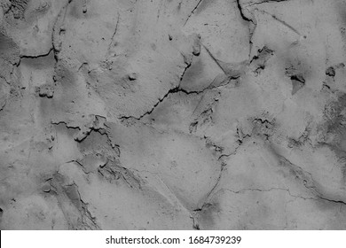 Texture of the old concrete wall with scratches, cracks, dust, crevices, roughness, stucco. Can be used as a poster or background for design.