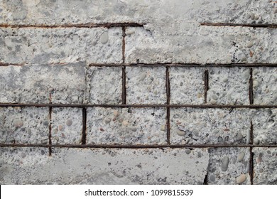 Texture of old gray concrete wall for background.Reinforced concrete with damaged and rusty metallic reinforcement