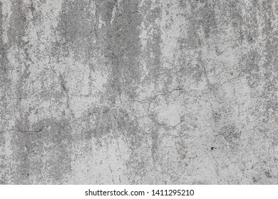 The texture of the old grey concrete wall with scratches, cracks, dust, crevices, roughness, stucco. Can be used as a poster or background for design