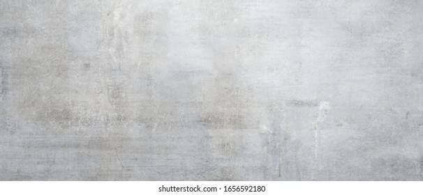 Texture of a old grungy gray concrete wall with cracks as a background or wallpaper