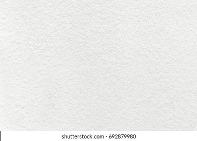 Texture of old light white paper background, closeup. Structure of dense cream cardboard.