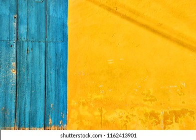 Texture of an old orange house in Trinidad Cuba.