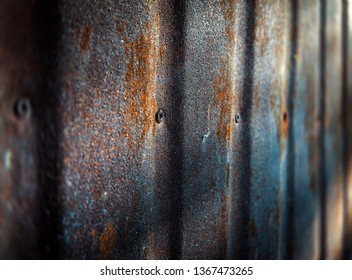 Texture of the old paint on rusty metal wall