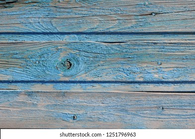 The texture of the old painted fence.