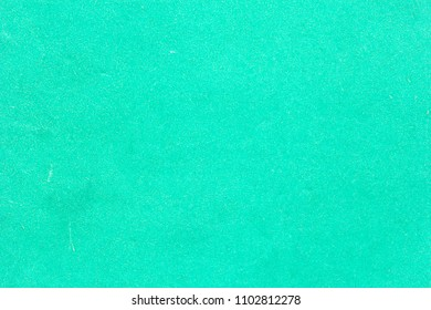 Texture of old parchment crumpled stained turquoise paper carboard for background
