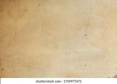 Texture of old retro vintage paper yellowed and worn out by time. Background