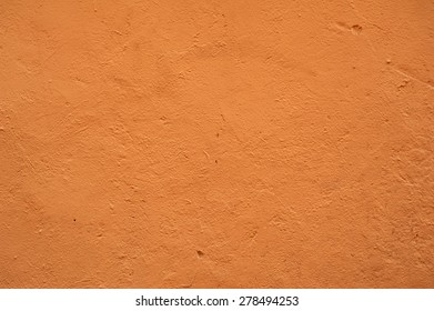 Texture of old rustic wall covered with brown stucco