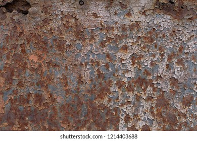 The texture of old rusty cracked painted metal surface