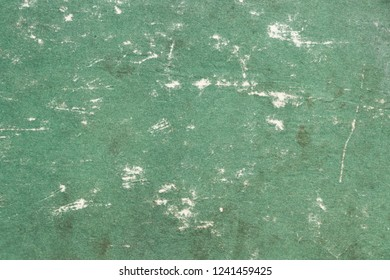 The texture of the old and shabby cardboard surface of green color. Obsolete paper. Vintage and grunge background with space for text or image. Empty template and mockup.