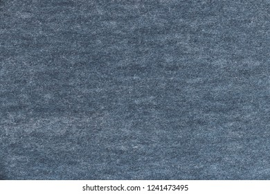 The texture of the old and shabby cardboard texture surface gray colour. Obsolete surface. Vintage and grunge background with space for text or image. Empty dark template and mockup.