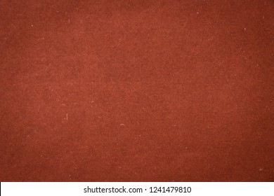 The texture of the old and shabby surface of the paper is brown with a vignette effect. Obsolete surface. Vintage and grunge background with space for text or image. Empty dark template and mockup.