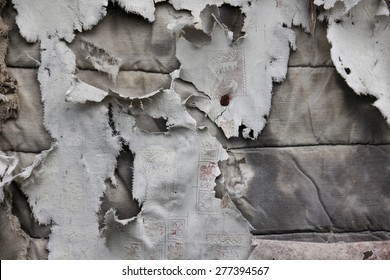 Texture of old torn fabric on wooden surface in grey colors