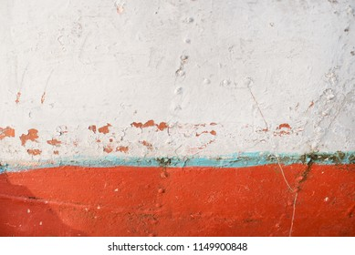 Texture of an old vintage rusty fishing boat painted with different colors.