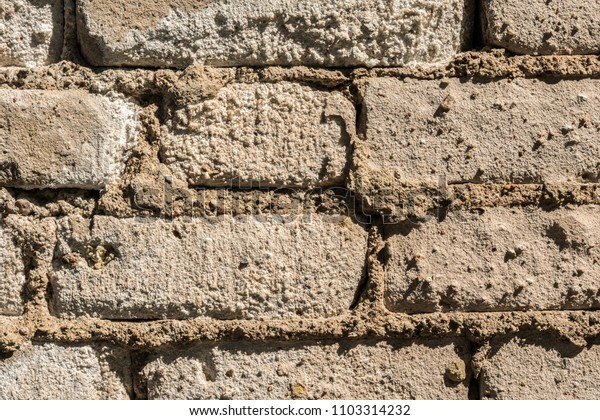 texture of the old wall of brick blocks, scattered brick and brickwork, architecture close-up abstract background